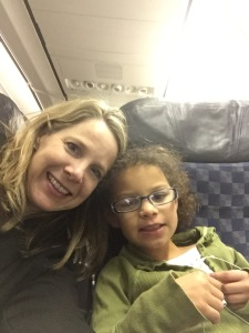 Kim and Bella on the plane headed for Rio.