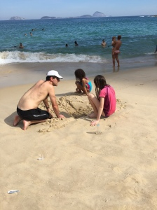 Jared and the girls digging a hole in the sand...just because we can.